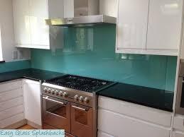 Splashback White Kitchen Turquoise Coloured Glass Splashback In A White Kitchen With Dark