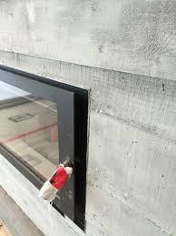 board form concrete plaster fireplace surround