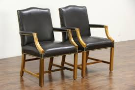 pair of leather office or library chairs with arms signed taylor vintage