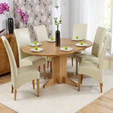 monty solid oak extending round dining table with 6 rome chairs 3903
