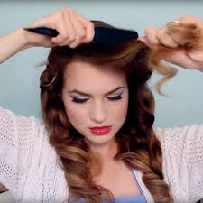 now curl the bottom layers of your hair and work your way up pinning and setting each curl wait for your curls to cool off pletely