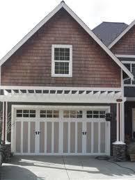 what do you guys think of garage door overhangs eyebrows