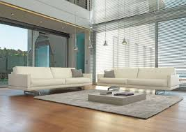 contemporary tan living room with white leather sofa and square white low coffee table on grey rug also laminated wooden flooring idea