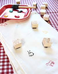 Stamped burp clothes for a barbeque-themed baby shower