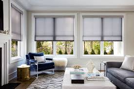illusion roller shade displayed in a living room setting