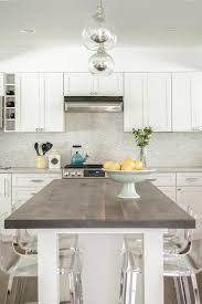 dark stained wood top kitchen island with clear acrylic counter stools