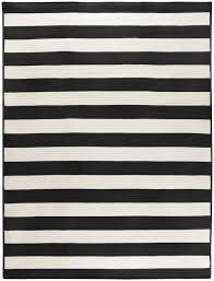 black and white striped rug brass and glass coffee table with