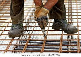 a rodbuster or iron worker working on a reinforcing rebar rebar worker