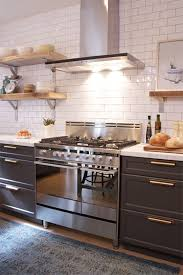 black cabinet pulls on gray cabinets. love it- dark cabinets black/gray white counters subway tile open shelves black cabinet pulls on gray c
