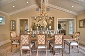 contemporary vaulted ceiling dining room beach style with upholstered dining chairs wood flooring table decorations