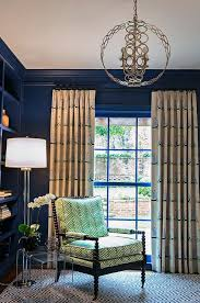navy blue nursery with beige and blue sailboard print curtains