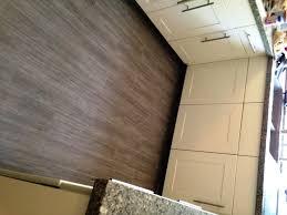 finished den area kitchen floor in wood porcelain tile