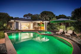 view in gallery fabulous pool house with al fresco dining and comfy seating for guests design acorn