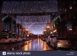 4th street los angeles with light decorations on rainy night