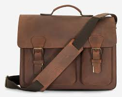 front view of brown leather satchel briefcase with asymmetric front pockets and shoulder strap