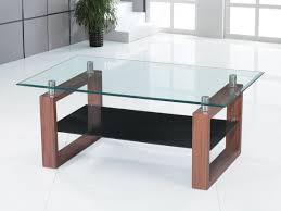 clear glass coffee table with black glass shelf