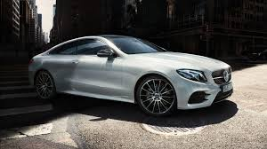 The illustrations may show accessories and optional. Mercedes Benz E Class Coupe Vehicle Highlights