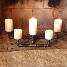 candle fireplace candle holders update an old fireplace with some new pipe decor holder impressive photos candle fireplace fireplace candle holders