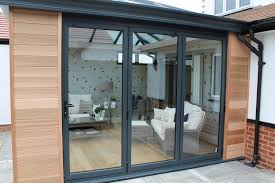 open plan living has bee an increasingly por trend for home refurbishment projects aluminium bi fold doors can transform a living e by opening