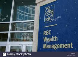 rbc wealth management a logo sign outside of an office building occupied by royal bank of