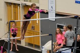 Summer Salt Gymnastics Invitational - Madeline Sims, level 4, jumping to  the high bar. | Palm Coast Observer
