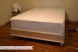 diy stained wood raised platform bed frame