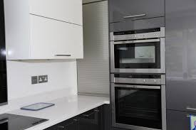Roller Shutter Kitchen Doors Shiny Magnolia Cream And Anthracite Grey Kitchen Neff Oven And