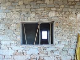 window stone wall opening window knocking window through stone walls can pose problems particularly when they are two feet thick 60cms and built