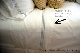 fitted sheet vs flat sheet on the v side bed making 101 the great debate and the skinny on