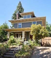 The 1907 American Foursquare has artistic details inside and out. The  body color is 'Gloucester Sage,' trim is 'Pittsfield Buff,' and sash and  doors are ' ...