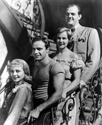 a streetcar d desire film vs text the cast of the film looking uncharacteristically cheerful warner bros a streetcar d desire
