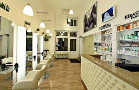 glamorous hair salon interior design ideas with tufted reception desk and superb pendant lamps