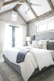 The gray, white, and navy tones in this master bedroom are breathtaking! We