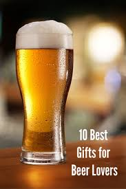 gifts for beer drinkers gl of light beer on a dark pub