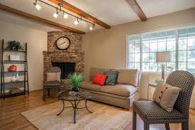 track lighting in living room. simple living room with corner fireplace and track lighting fixtures in
