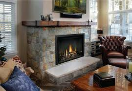 gas fireplace glass doors closed enhance elegant beauty rustic barn wood inspired mantel including decorative brackets