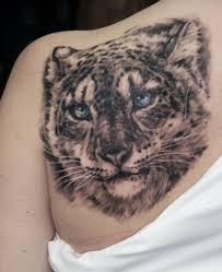 татуировка на лопатке у девушки тигр фото рисунки эскизы
