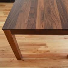 solid walnut dining table by matthew mabee