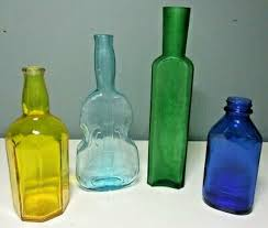 lot of 4 small assorted colored glass bottles