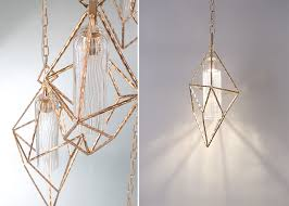 hand crafted golden metalwork houses a sleek seeded led pendant the geometric diamond caged design is inspired by the organic asymmetric beauty of