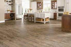 Image Wood Floors Etched Light Brown 12mm Laminate Flooring By Armstrong Laminate Armstrong The Flooring The Flooring Factory Etched Light Brown 12mm Laminate Flooring By Armstrong The