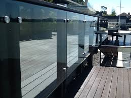 close up view of a deck railing with 2 diameter 316 stainless steel standoffs