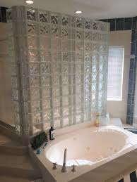 we installed travertine tile throughout the shower walls and tub surround with an mosaic arabesque tile used as accents around the shower head and inset