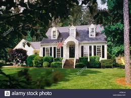 House With Black Trim Small White House With Dormers Black Trim And An American Flag