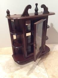 vintage wooden display cabinet with mirrored back and glass door for on the wall
