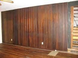 dark wood paneled wall in living room