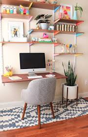 Colorful home office design featuring wall mounted desktop and shelving -  Home Office Ideas & Decor