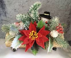1960s 1970s vine plastic flower christmas centerpiece with google e snowman on a birch yule log