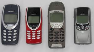nokia phones 2000. a selection of nokia phones from 2000: 3310 (basic consumer), 8210 ( 2000 l