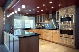 Modern Kitchen with Pendant Light by Gary Carlson | Zillow Digs ... & Modern Kitchen with Glass panel, U-shaped, limestone tile floors, Frigo  Design Adamdwight.com